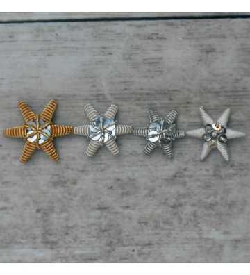 Estrella bordada en canutillo de plata